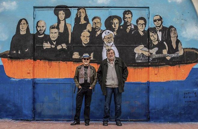 Francesco Guccini e Mauro Pagani murales Bologna Note di Viaggio Natale a Pavana